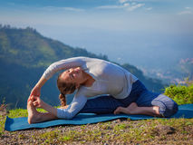 Young sporty fit woman doing Hatha Yoga asana Royalty Free Stock Image