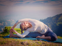 Young sporty fit woman doing Hatha Yoga asana Stock Photography