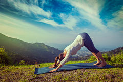 Young sporty fit woman doing yoga oudoors in mountains Stock Image