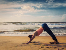 Young sporty fit woman doing yoga oudoors at tropical beach Royalty Free Stock Photography