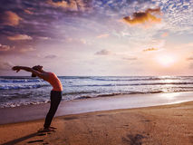 Young sporty fit woman doing yoga Sun salutation Surya Namaskar Royalty Free Stock Photo