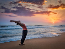 Young sporty fit woman doing yoga Surya Namaskar Royalty Free Stock Image