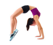 Young sporty girl does gymnastic exercises Royalty Free Stock Photography