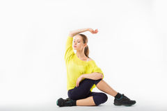 Young sporty girl does gymnastic exercises Stock Images