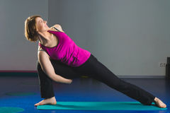 Young Sporty Girl doing gymnastic exercises in fitness class Royalty Free Stock Image