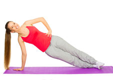 Young sporty girl doing gymnastic exercises Stock Photos