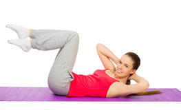 Young sporty girl doing gymnastic exercises Stock Images