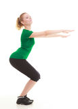 Young sporty girl doing stretching exercise isolated Royalty Free Stock Images
