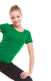 Young sporty girl doing stretching exercise isolated Stock Photos