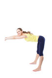 Young sporty girl doing stretching exercises sitting on the floor Stock Images