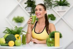 Free Young Sporty Girl Drinking Healthy Vegetable Juice Royalty Free Stock Images - 169786119