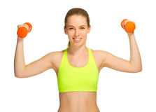 Young sporty girl with dumbbells Royalty Free Stock Photo
