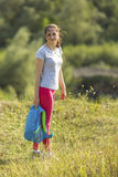 Young sporty girl standing outdoors. Walking. Royalty Free Stock Photo
