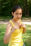 Young sporty girl strikes Royalty Free Stock Image