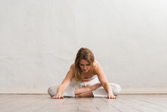 Young and sporty girl training in gym. Yoga exercise Stock Photo