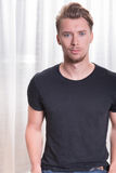 Young sporty man with black t-shirt Stock Photos