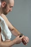 Young sporty man checking his fitness tracker Royalty Free Stock Photos