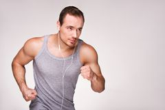 Young sporty man with headphones running Royalty Free Stock Images