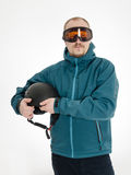 Man with goggles hold ski helmet Stock Photography