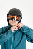 Man with goggles putting on ski helmet Royalty Free Stock Photo