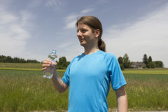 Young sporty man outdoors with a water bottle Stock Photography