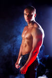 Young sporty man over Smoke. Royalty Free Stock Image