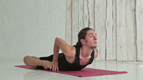 Young sporty man practicing ashtanga yoga in fitness studio stock video
