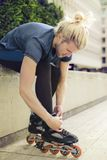 Young sporty man with skaters Royalty Free Stock Images