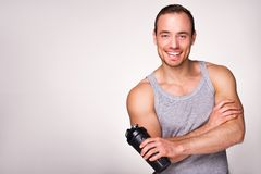 Young sporty man with sport shaker Royalty Free Stock Photo
