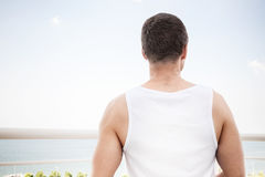 Young sporty man starring at the sea Royalty Free Stock Photo