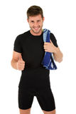 Young sporty man with thumb up Stock Images