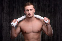 Young sporty man with towel after workout Royalty Free Stock Image