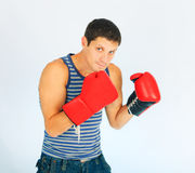 A young sporty men. In a red boxing gloves stock photo