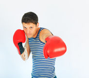 A young sporty men. In a red boxing gloves stock image