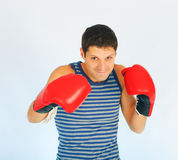 A young sporty men. In a red boxing gloves stock photos