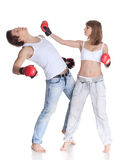Young sporty people in fighting gloves. Royalty Free Stock Photos