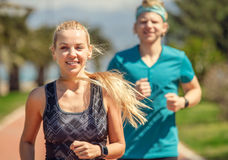 Young sporty people on jogging Stock Photo