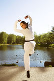 Young sporty woman. Jumping near the lake Stock Images