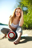Young sporty woman with ball on the beach Royalty Free Stock Images