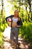 Young sporty woman with ball in summer park Stock Images