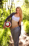 Young sporty woman with ball in summer park Stock Photos