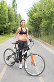 Young sporty woman with bicycle, healthy life concept. Royalty Free Stock Photo