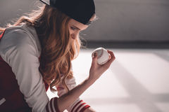 Young sporty woman in cap holding baseball ball Royalty Free Stock Photo