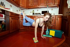 Young sporty woman is cleaning the apartment. royalty free stock photos