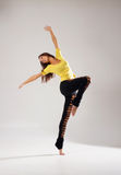 A young and sporty woman dancing in sexy clothes Stock Image