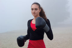 Young sporty woman does boxing exercises during fitness workout Stock Image