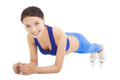 Young sporty woman doing core exercise. In studio stock photos
