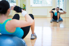 Young sporty woman doing exercises on bosu ball Royalty Free Stock Image
