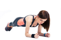 Young sporty woman doing exercises on the floor Stock Photos