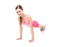 Young sporty woman doing exercises over white Stock Image